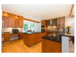 It'sequipped with an island, professional quality appliances, granite counters, walk-in pantry & breakfast room.