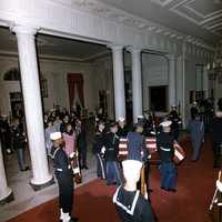 President Kennedy's body enters the White House accompanied by the Honor Guard, members of the Kennedy Family, others. White House, Cross Hall, 23 November 1963.