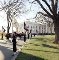 The Caisson enters the White House grounds after returning from the Capitol, 25 November 1963.
