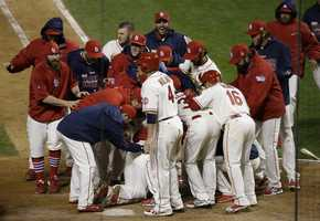 St. Louis Cardinals players celebrate with Allen Craig, on ground, after Craig scored the game-winning run on an obstruction play in ninth inning of Game 3 of baseball's World Series against the Boston Red Sox Saturday, Oct. 26, 2013, in St. Louis. The Cardinals won 5-4 to take a 2-1 lead in the series. (