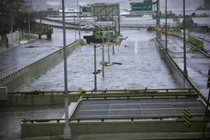 Water reaches the street level of the flooded Battery Park Underpass, Tuesday, Oct. 30, 2012, in New York.