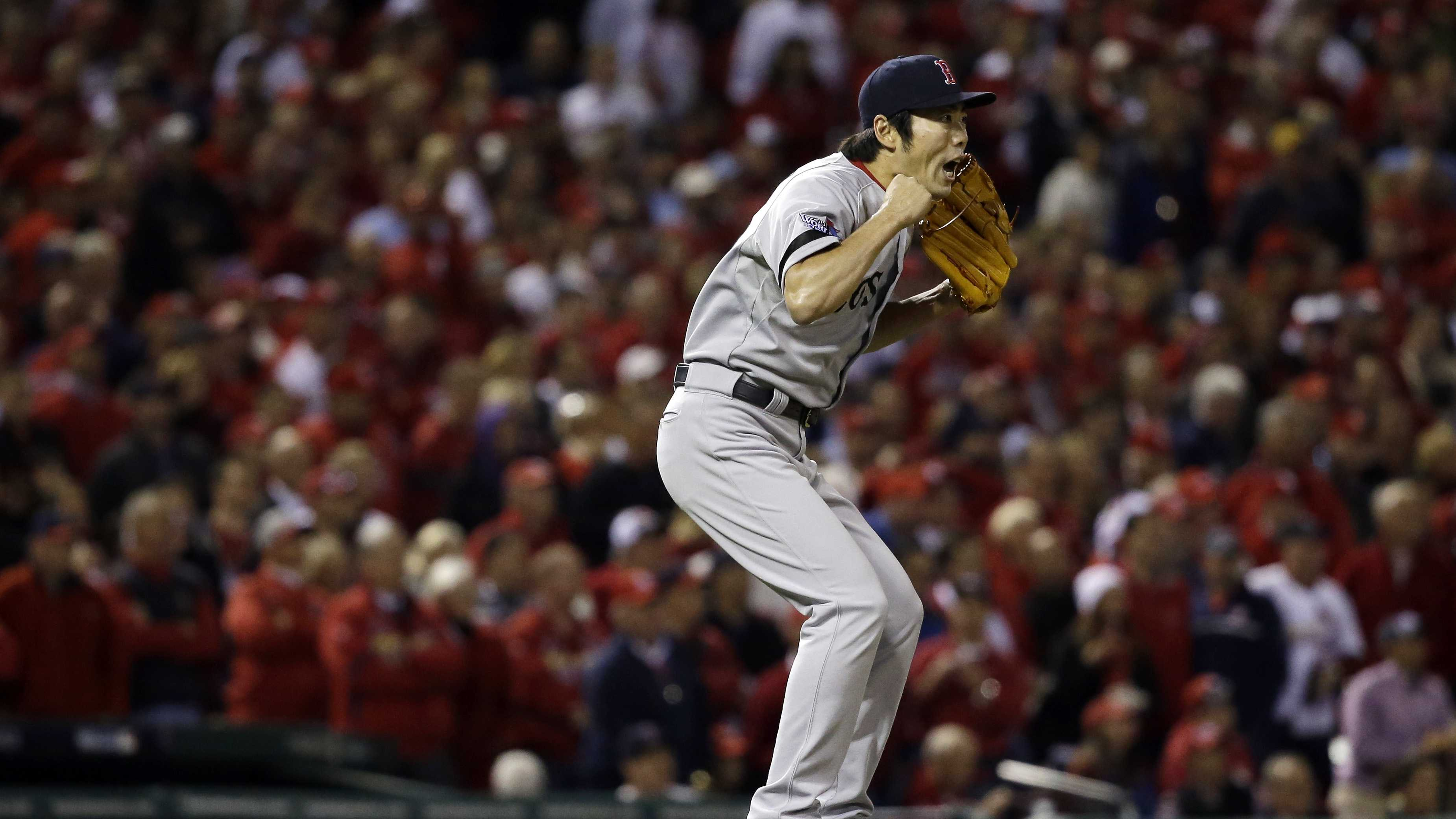 Koji Uehara Jumps after Game 5 final out 1012813