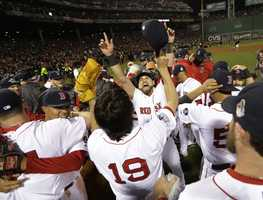 The Boston Red Sox celebrate after defeating the St. Louis Cardinals in Game 6 of baseball's World Series Wednesday, Oct. 30, 2013, in Boston. The Red Sox won 6-1 to win the series.