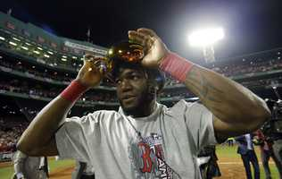 Boston Red Sox's David Ortiz adjust his goggles after Boston Red Sox defeated St. Louis Cardinals in Game 6 of baseball's World Series Wednesday, Oct. 30, 2013, in Boston. The Red Sox won 6-1 to win the series.