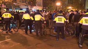 Police push back crowds in the Back Bay.