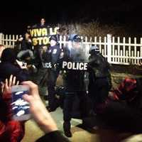 Police were forced to don riot shields and protective gear.
