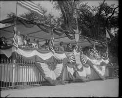 Mayor Curley and wife on reviewing stand near State House in 1918
