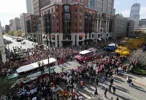 Duck Boats carrying Boston Red Sox players make their way down Boylston Street during a victory parade celebrating the team's third World Series title since 2004, Saturday, Nov. 2, 2013, in Boston.