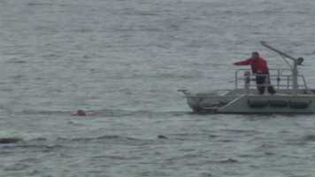 The Beverly harbormaster said the swimmer's friends called police after he failed to come back to shore.