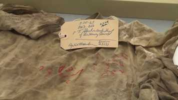 The evidence tag on Oswald's T-shirt.