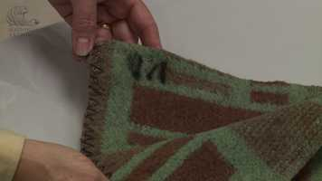 A green and brown blanket that Oswald was said to have used to store the rifle.