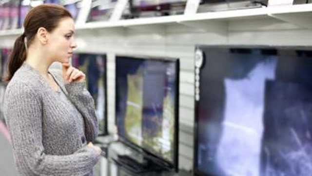 Woman shopping for TV generic