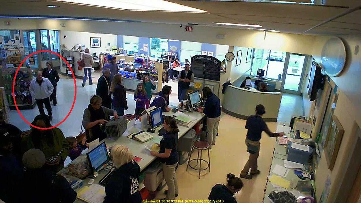 The couple - circled in red - in the crowded MSPCA Nevins Farm lobby before leaving with Sophie (credit MSPCA-Angell).JPG