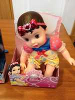 """Disney Baby Snow White by Tollytots LimitedWATCH SAYS: Oral-age children as young as 2-years-old are encouraged to add """"Baby Snow White"""" to their """"royal nursery"""" collection. The doll is sold wearing a detachable headband with a plastic heart-adorned bow that poses the potential for choking if ingested."""