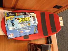 """Spooner Freestyle by Spooner, Inc.WATCH SAYS: The """"Spooner"""" is a polyethylene board resembling a skateboard without wheels. Marketed as the """"ultimate fun board!""""children are encouraged to go online for """"trick tips,"""" such as the """"180° Spin"""" and """"The Flipper,"""" which can be done """"on all surfaces."""" The manufacturer makes no mention of safety gear, and children pictured on the packaging are not wearing helmets or other safety protections."""