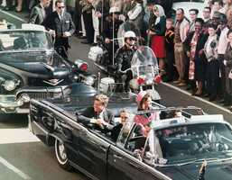 President John F. Kennedy's motorcade travels through Dallas.