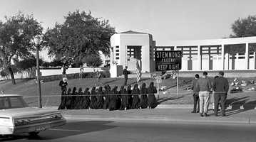 In this Nov. 25, 1963 file photo, Roman Catholic nuns kneel and pray at the place where President John F. Kennedy was shot and killed in Dallas, on the day of his funeral in Washington.