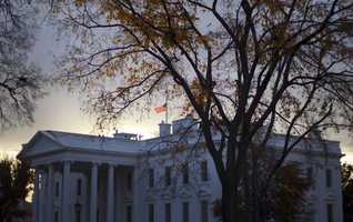 A flag flies at half-staff above the White House in Washington early Friday morning, Nov. 22, 2013. President Barack Obama ordered that flags be lowered at government buildings to mark the 50th anniversary of President John F. Kennedy's assassination. Obama says the anniversary is a day to honor Kennedy's memory and 'celebrate his enduring imprint on American history.' Obama says Kennedy's vision for the U.S. and the world lives 'in the generations he inspired.""