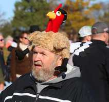 Michael Chilcot, of Middleboro, wears his turkey hat while making a phone call along the parade route