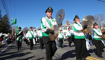 A marching band at the America's Hometown Thanksgiving Parade in Plymouth.