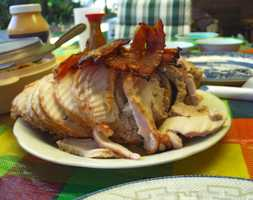 Choose four ounces of turkey breast with no skin and save 70 calories (You might want to leave off the bacon).