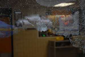 Broken glass at the front entrance to Sandy Hook Elementary School.
