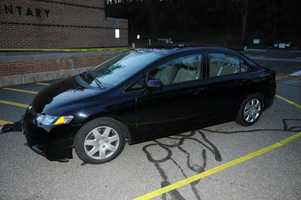 Shooter's car parked outside Sandy Hook Elementary School.