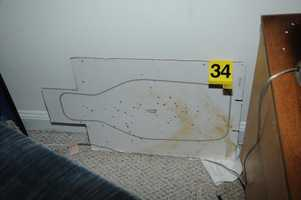 Cardboard shooting target from behind couch in family room area of basement.