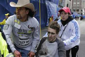 "Jeff Bauman lost his legs in the bombings was wheeled away with the help of Carlos Arredondo. ""Boston Strong"" quickly became the rallying phrase in the aftermath of the blasts."