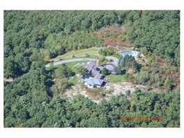 The 27-acre lot is adjacent to conservation land.