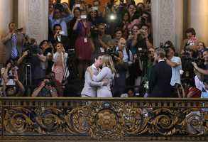 Kris Perry, foreground left, kisses Sandy Stier as they are married at City Hall in San Francisco, Friday, June 28. Stier and Perry were married after a federal appeals court cleared the way for the state of California to immediately resume issuing marriage licenses to same-sex couples after a 4 1/2-year freeze.