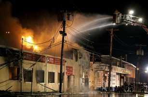 Firefighters battle a blaze in a building on the Seaside Park boardwalk on Thursday, Sept. 12, in Seaside Park, N.J. The fire began in a frozen custard stand on the Seaside Park section of the boardwalk and quickly spread north into neighboring Seaside Heights.