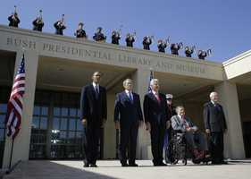 From left, President Barack Obama, former president George W. Bush, former president William J. Clinton former President George H.W. Bush and former president Jimmy Carter arrive for the dedication of the George W. Bush Presidential Center Thursday, April 25, 2013, in Dallas.