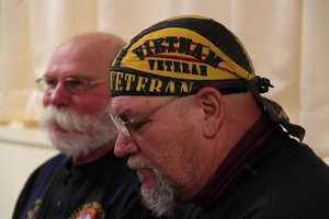 Vietnam veteran Wayne Abernathy of North Chesterfield, Va., with David Haskell, of Maine, sitting behind him.