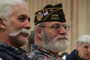 Ipswich veterans look on during the ceremonies.