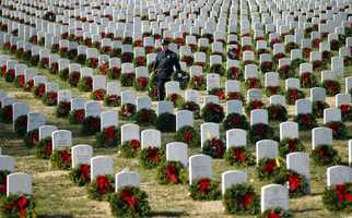 Wreaths Across America expects to ship 470,000 to 500,000 wreaths this month to veterans' graves in more than 900 locations. Starting Sunday, 11 trucks began rolling toward Arlington National Cemetery from Maine.
