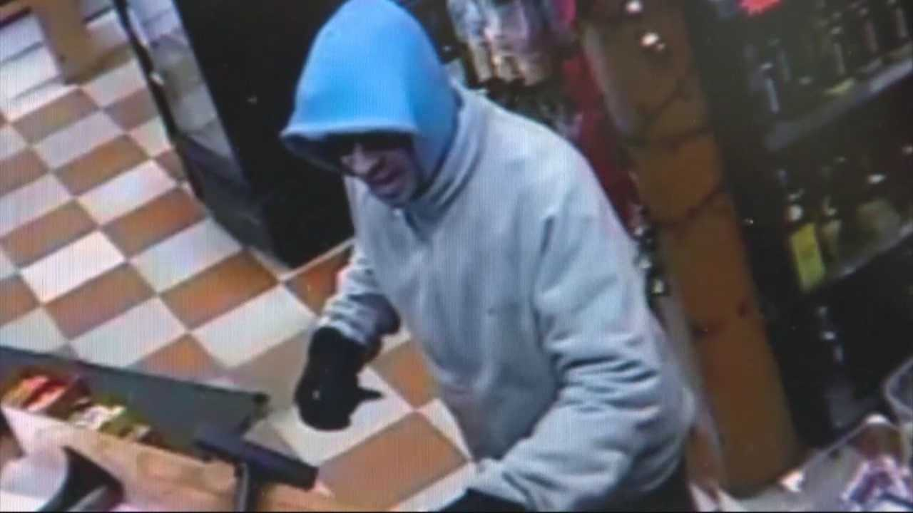 Security footage shows man pull knife on clerk, steal cash register