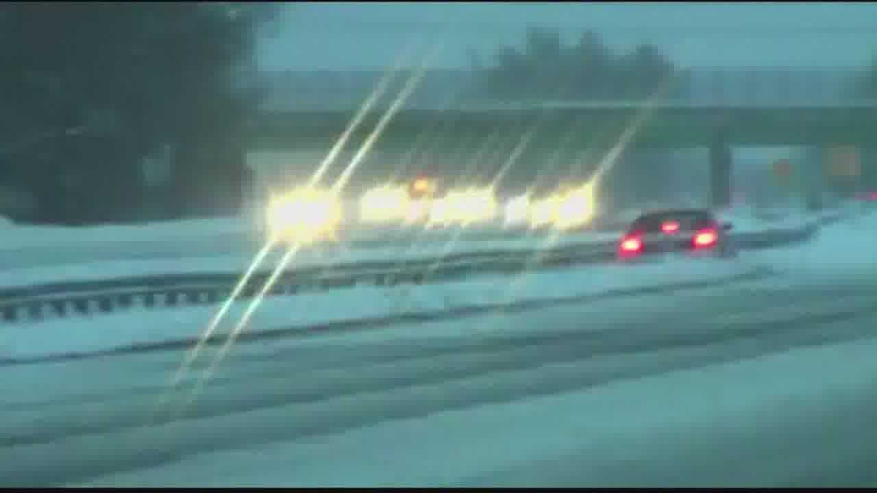 Video captures car sliding, spinning out on highway