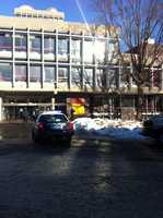 A Harvard University Police patrol car sits outside the Science Center Monday morning after bomb threats forced evacuation of the building
