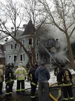 Fire ripped through a two story home in the Dorchester neighborhood of Boston around lunchtime Tuesday.