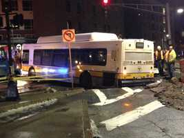 An MBTA bus was stuck in a sinkhole in South Boston early Saturday morning.