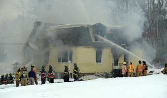 A four-alarm blaze destroyed a single family-home in Westford Friday.
