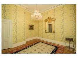 There are magnificent original ornate moldings and medallions, pocket doors and 13' ceilings.