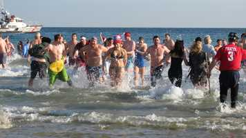 "Chilly temperatures didn't stop people from jumping into the water at Good Harbor Beach in Gloucester Saturday to support ALS research at the second-annual ""Plunge 4 Pete"""