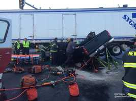 The truck was pinned under the tractor-trailer.