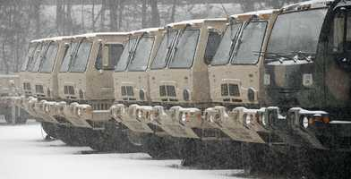 National Guard trucks in Hingham warm up for deployment if needed by local authorities.