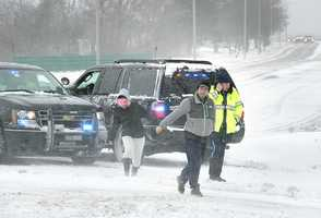 Drivers check with State Police who had sections of Quincy Shore Drive closed during high tide. Blizzard conditions affected travel and pedestrians, as a major winter storm hit Quincy, Thursday, Jan. 2, 2014.