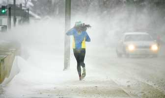 Lauren Donahue, of Marshfield, is resilient to blizzard conditions along Quincy Shore Drive as she trains for the 2014 Boston Marathon, the first where she has an official number, as a major winter storm hit Quincy, Thursday, Jan. 2, 2014.