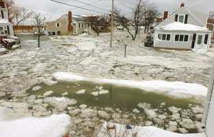 A flooded 10th Ave. in Scituate has water at mailbox levels. A major nor'easter included heavy snowfall and coastal flooding in Scituate, Friday, Jan. 3, 2014.
