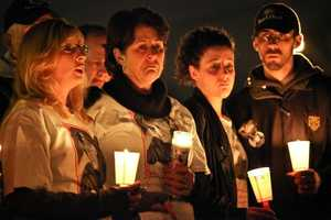 Dorothy MacLean, second from left, holds a candle during a vigil to mark the anniversary of Jennifer Lynn Fay's disappearance. Joining her from left are Michelle Littlefield, president of the Jennifer Lynn Fay Foundation&#x3B; Yvette Churchill, Jennifer's sister&#x3B; and Jim Morrison, Jennifer's brother.
